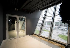 Fire-resistant glazed doors in project Encore Fitness
